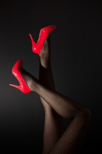 http://www.dreamstime.com/stock-images-head-over-high-heels-pair-sexy-legs-red-kicked-air-black-background-image30621264