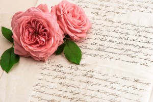 http://www.dreamstime.com/royalty-free-stock-photography-pink-rose-flowers-over-antique-handwritten-letter-romantic-vintage-background-selective-focus-image39674437