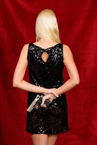 http://www.dreamstime.com/royalty-free-stock-photos-woman-evening-dress-hidden-weapon-image8429678