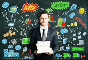 http://www.dreamstime.com/stock-photos-man-books-business-diagram-drawn-blackboard-concept-close-up-image61337073