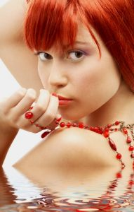 http://www.dreamstime.com/royalty-free-stock-images-redhead-red-beads-looking-over-shoulder-image4383419